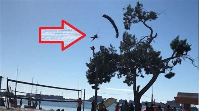 Acemi paraşütçü kadın ağaç dallarıyla problem yaşıyor