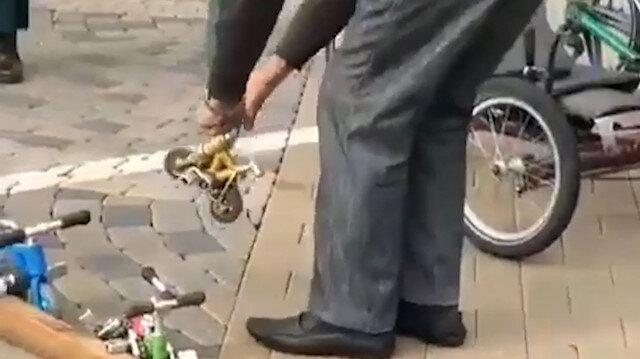Dünyanın en küçük bisikletini kullanan adam